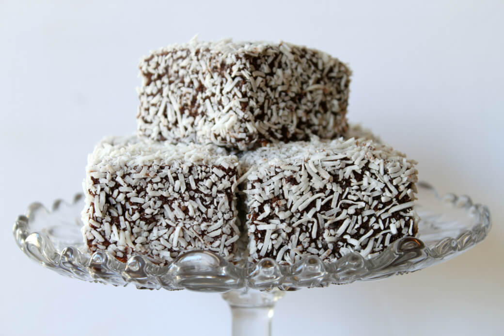 A crystal platter holds three lamingtons.