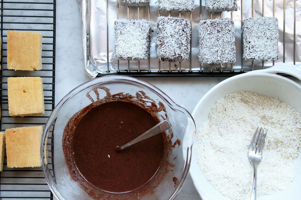 The set up for covering lamingtons in chocolate and coconut.