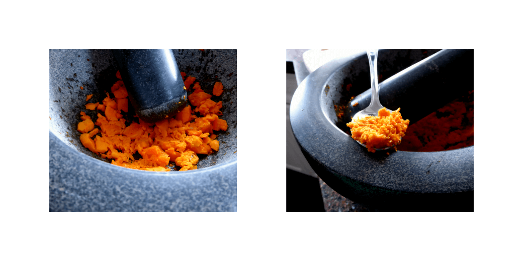 Turmeric being ground with a mortar and pestle.