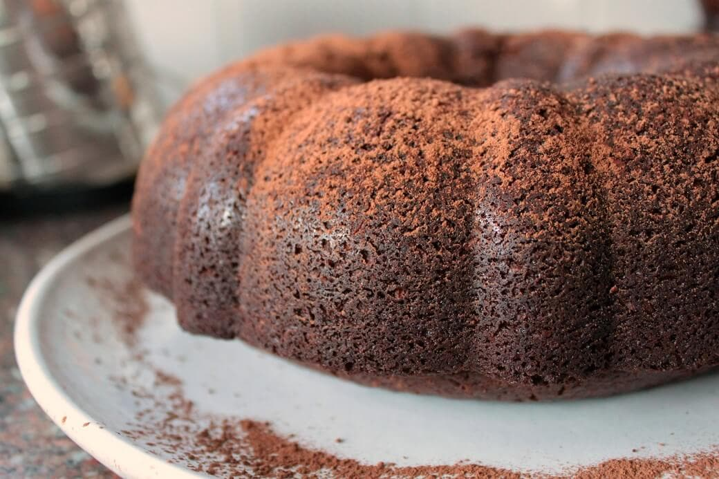 This Chocolate Porter Coconut Cake is a rich, dense cake with a bit of sweetness from coconut and a whole lot of flavour from Longboat Chocolate Porter. #chocolatecake #chocolateporter #stoutcake #davidlebovitz #bundtcake