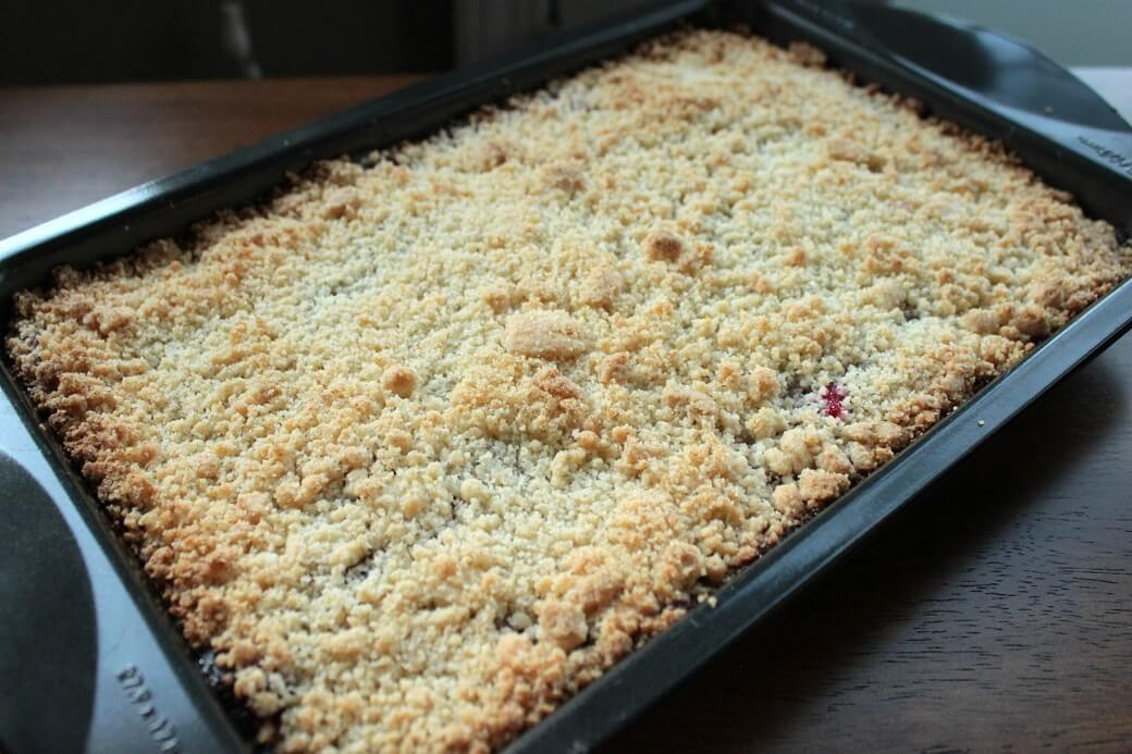 Cranberry Bars - Baking pan with uncut cranberry bars.