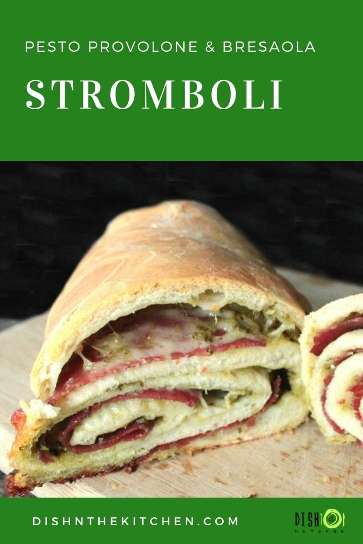 Pinterest image of Italian Baked Stromboli Sandwich on a cutting board.