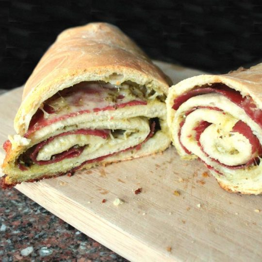 Bresaola Stromboli are baked Italian rolled sandwiches filled with pesto, provolone, and Italian bresaola. Make the dough and personalize with your own Stromboli flavours!
