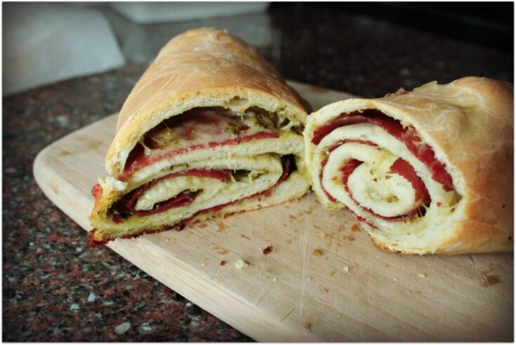 Italian Baked Stromboli Sandwich on a cutting board.