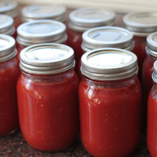 Make the most out of ripe Roma tomatoes by preserving them in this simple passata. It's delicous on it's own with pasta or used in your favourite recipe. #Passata #preserving #canning #tomatosauce #hotwaterbath
