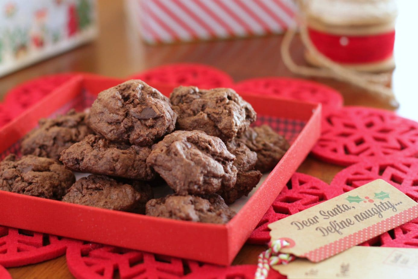Ancho Chili Chocolate Cookies Pinterest image of brown cookies in a red gift box.