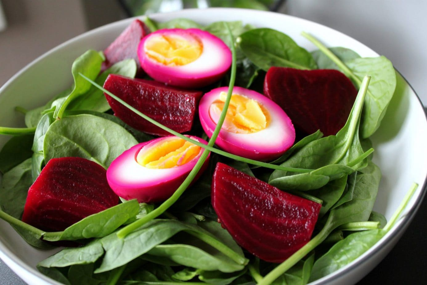 Pickled Egg and Beet Spinach Spring Salad - Dish 'n' the Kitchen Wake Up those tastebuds with this eye catching beet marinated pickled egg, beet and spinach salad. Make it ahead of time, then throw it together at the last minute. It's THE perfect hostess make ahead salad. #pickledbeets #spinachsalad #salad