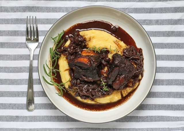 Easy Peasy Classic Beef Comfort dish with a blueberry and balsamic flavour spin. Cook these Braised Short Ribs low and slow until they reach fall-off-the-bone deliciousness. #beefribs #onepot #braised #braisedribs