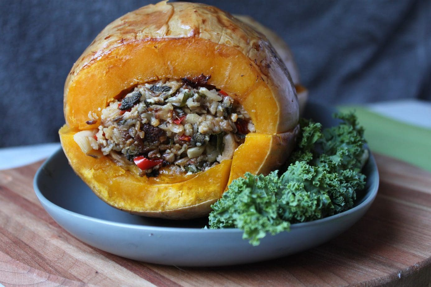 This entire stuffed and roasted butternut squash makes a great holiday side dish or main dish for vegans and vegetarians. Delicious and meant to mimic the famous turducken at your holiday table. #vegan #vegetarian #sides #veggiedukken