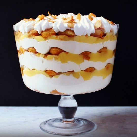 A bright layered Tiramisu Trifle Dessert featuring lemon curd and mascarpone. #tiramisu #trifle #lemoncurd #mascarponecream #dessert #Easterdessert