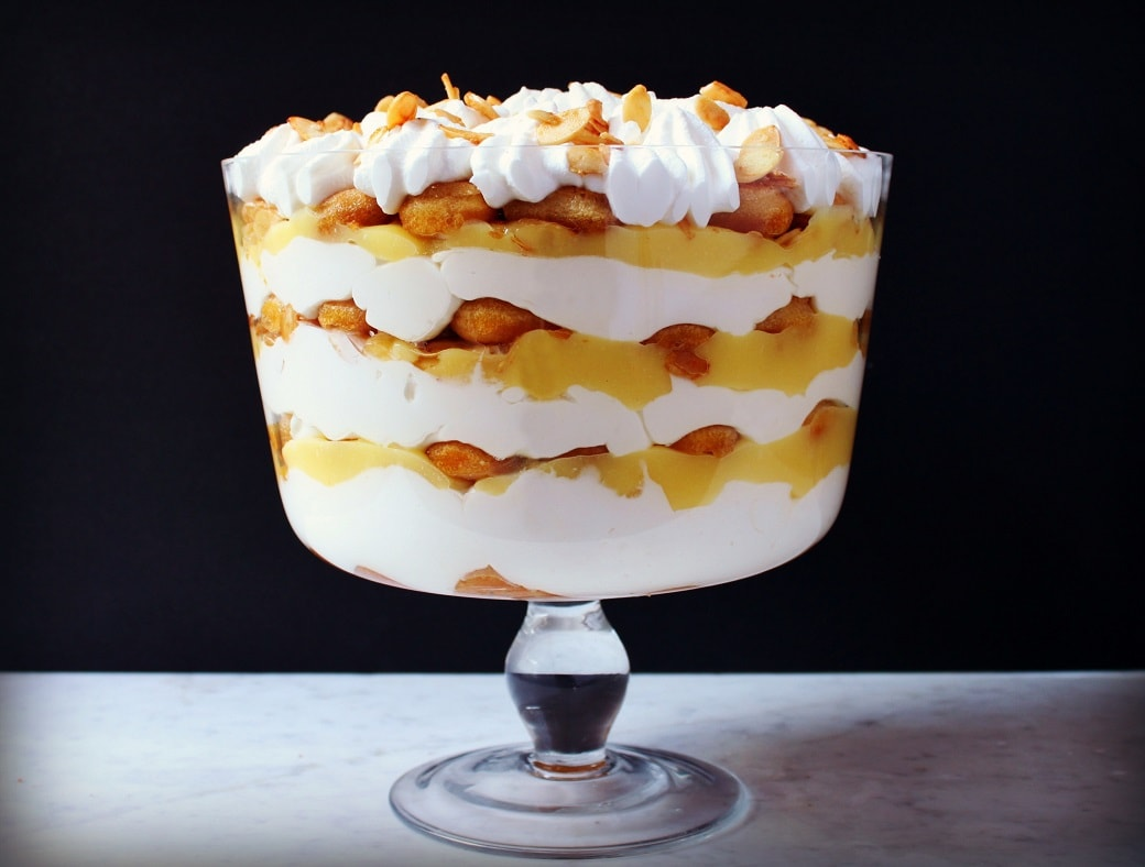 A bright layered Tiramisu Trifle Dessert featuring lemon curd and mascarpone in a glass bowl.