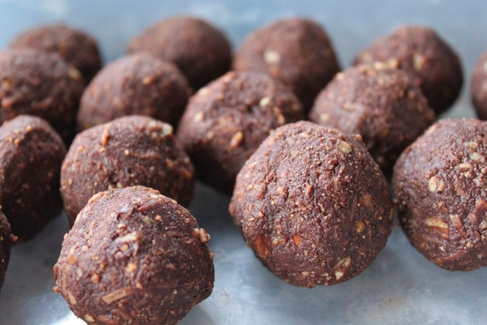 Chocolate covered Nanaimo Truffles sitting on parchment paper.