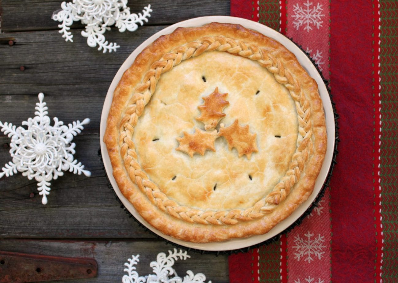 Our family's favourite Christmas Eve Tourtière. A treasured recipe and traditional French Canadian dish sure to fill tummies and satisfy on Christmas Eve. #Tourtière #Christmas #Pie #ChristmasTradition #FrenchCanadian