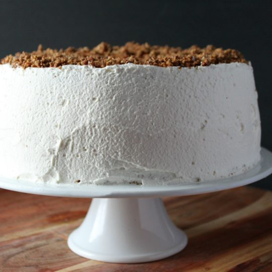 A soft n chewy pecan torte layered with sweetened whipping cream