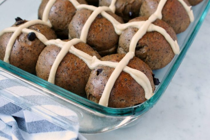 Mocha and Chocolate Chip Sourdough Hot Cross Buns - A glass baking dish containing baked hot cross buns.