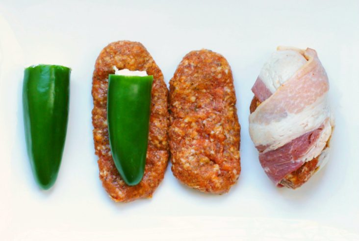 The Ultimate Summer BBQ Appy - Jalapenos stuffed with cream cheese, wrapped in spicy chorizo sausage meat and covered in bacon. #appy #appetizer #grilling #chorizo #jalapeno #bacon