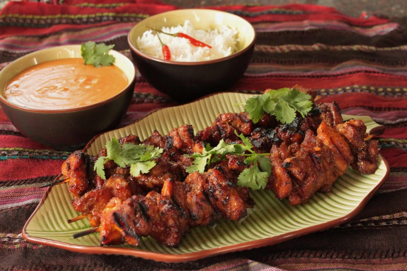 Get out your grilling sticks because you're going to want to try this great recipe for a Classic Thai street food...Chicken Satay. #chickenSatay #grilling #satay #foodonsticks