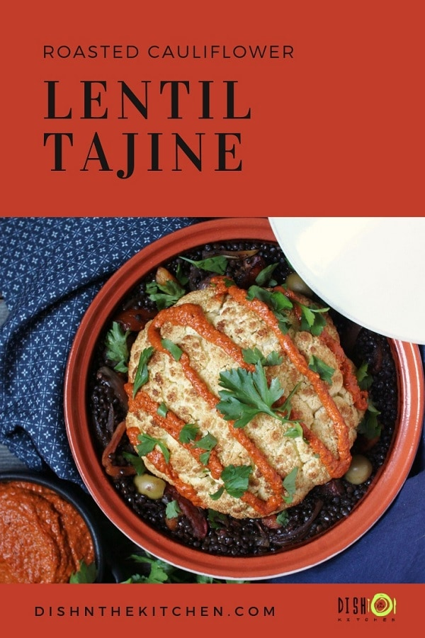 Pinterest image of a red clay tajine holding a roasted whole cauliflower on a bed of lentil stew.