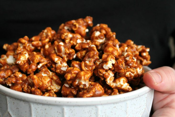 A bowl filled with Gingerbread Caramel Popcorn