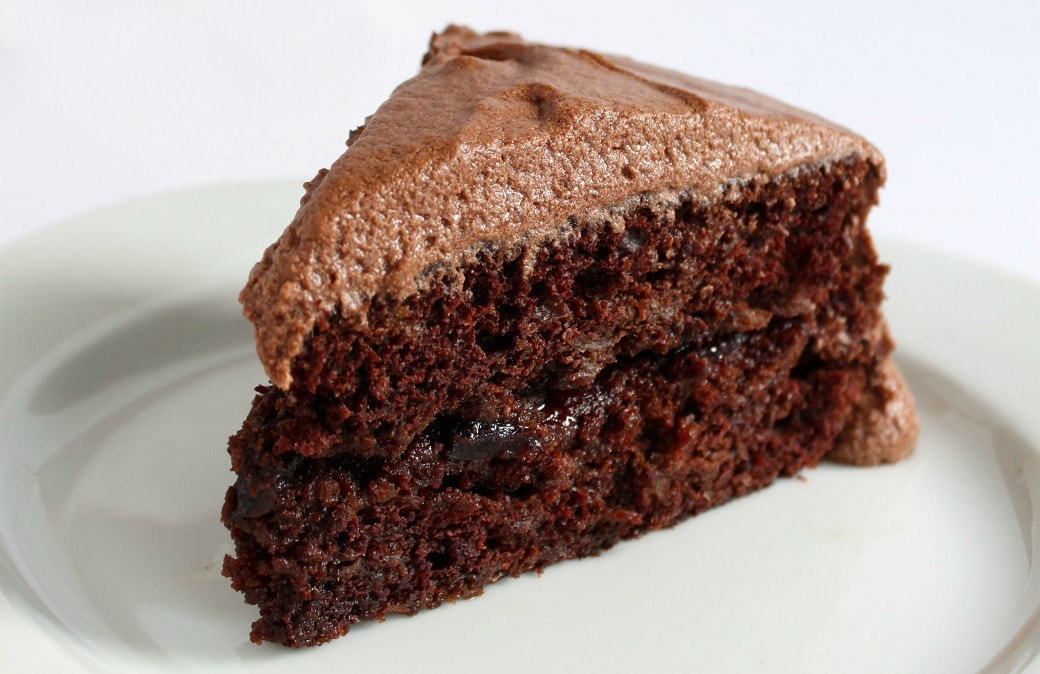 Sauerkraut Chocolate Cake - A generous slice of frosted chocolate cake on a white plate.