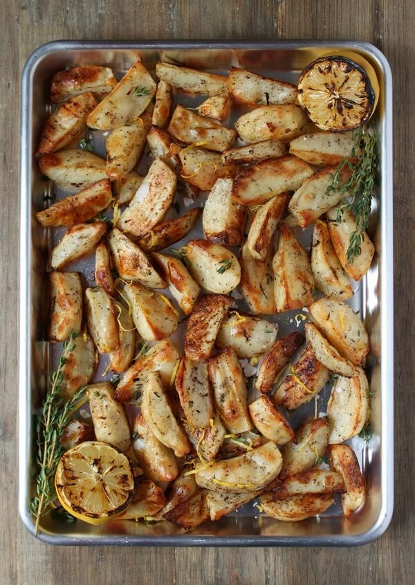 These perfectly roasted potatoes are so easy to make. Add lemon juice and zest for brightness and lemon pepper for a bit of a peppery kick. #lemonpotatoes #roastedpotatoes #sides
