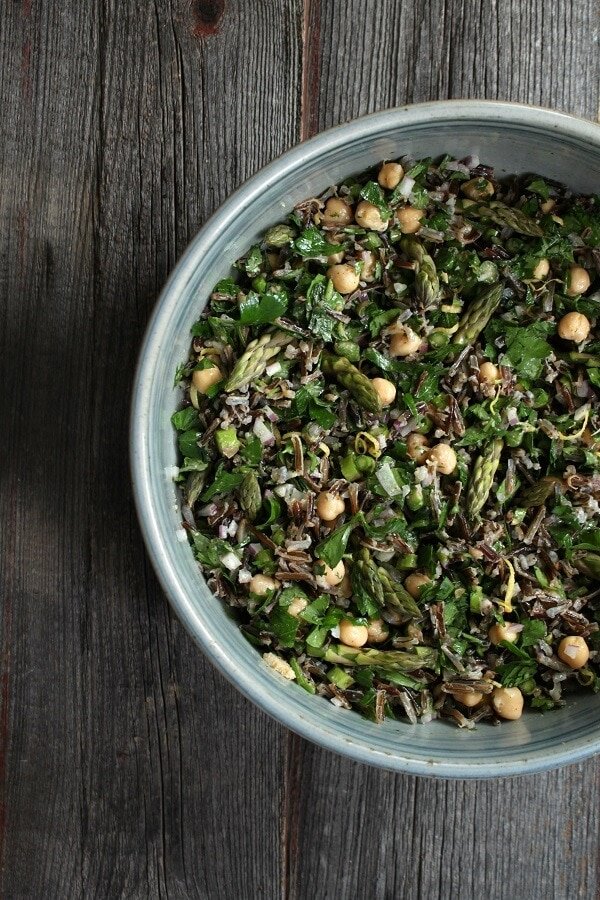 An overhead shot of a bowl of wild Rice Asparagus Salad made with fresh asparagus and of wild rice.