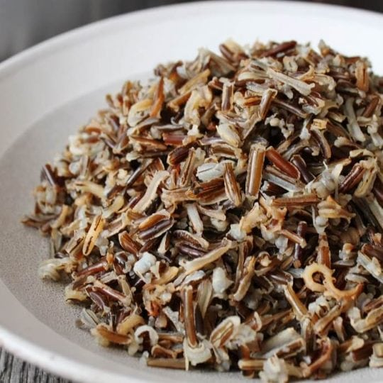 A quick tutorial on how to cook the best wild rice right on your stove. Serve as a side dish or add this healthy grain to salads or soups. #wildrice #rice #sides