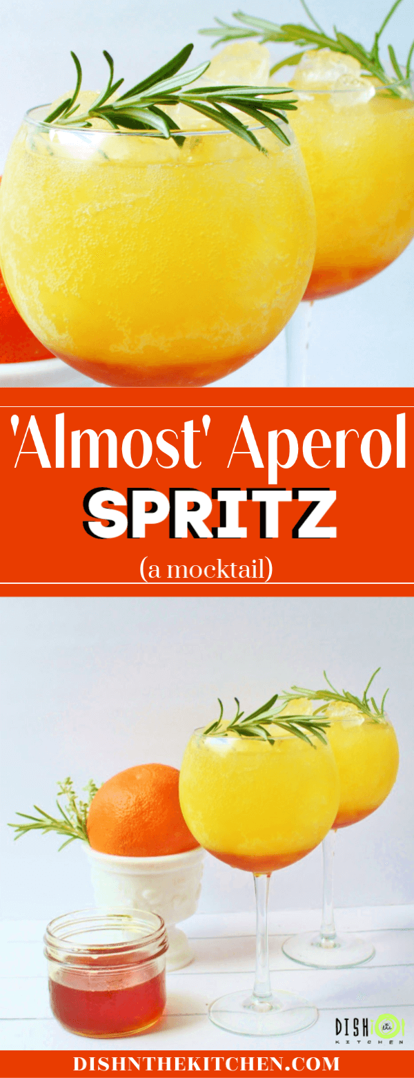 A bright orange drink garnished with fresh rosemary.