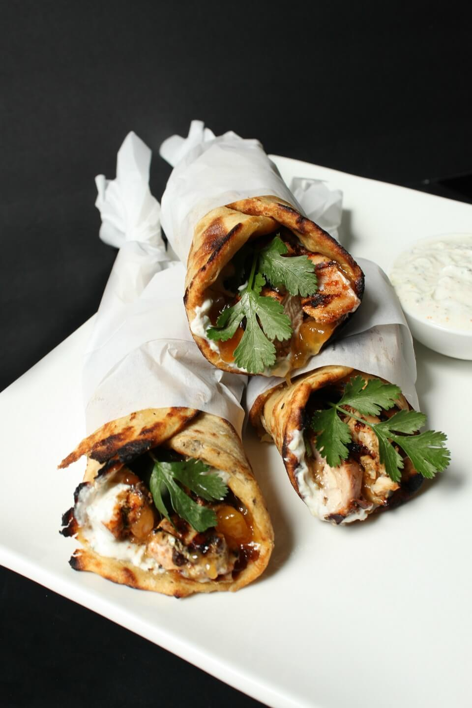 grilled chicken recipe which makes delicious tandoori chicken wrapped in paratha along with cilantro, mango chutney, and raita.