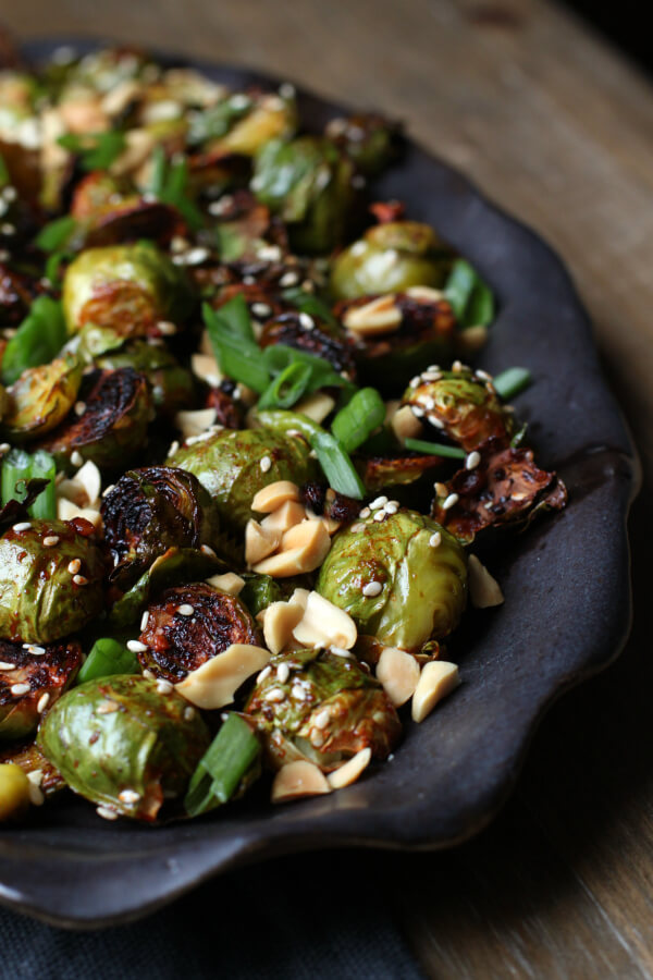 Maple Gochujang Roasted Brussels Sprouts are a delicious side dish featuring tender Brussels Sprouts tossed with sweet and spicy maple gochujang sauce then caramelized to perfection. #vegetables #brusselssprouts #sidedish #gochujang