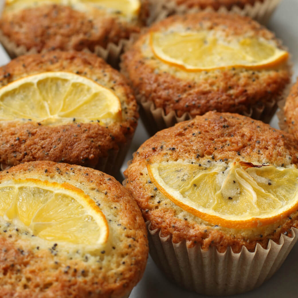 Close up of Lemon Poppy Seed Muffins topped with lemon slices.