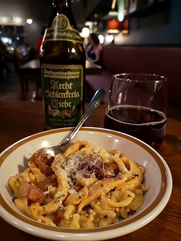 Rain Dog Bar - A plate of hand cut spaetzle with a beer.