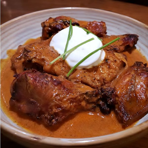 Rain Dog Bar - Chicken wings in a paprikash sauce topped with a dollop of créme fraiche..