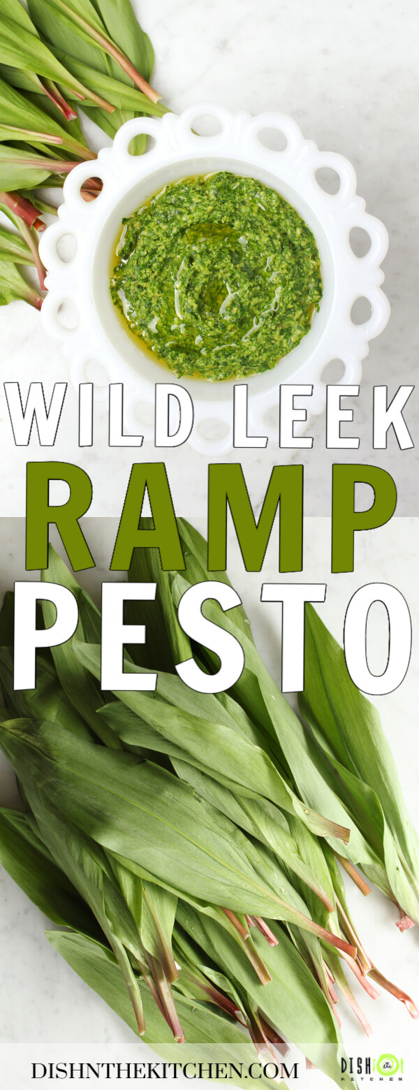 Pinterest image of a scalloped white bowl filled with vibrant green pesto surrounded by ramp leaves.