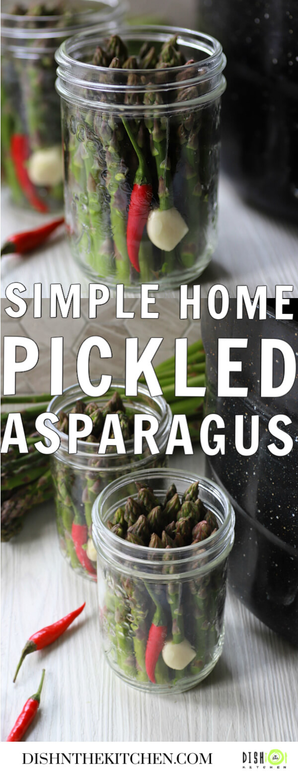 Pinterest image of clear glass jars filled with green asparagus, a garlic clove, and a red hot pepper.
