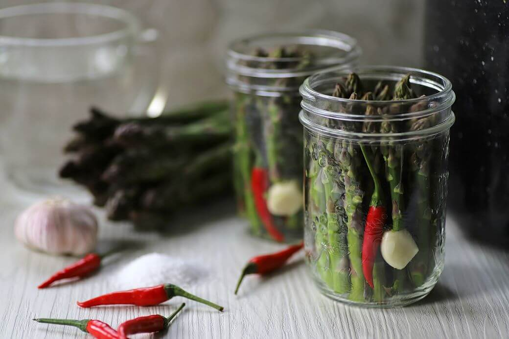 Fresh asparagus, garlic bulb, hot red peppers, salt and vinegar.