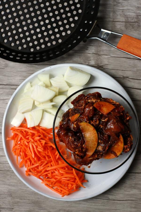 Ingredients and grilling basket used to make beef bulgogi.