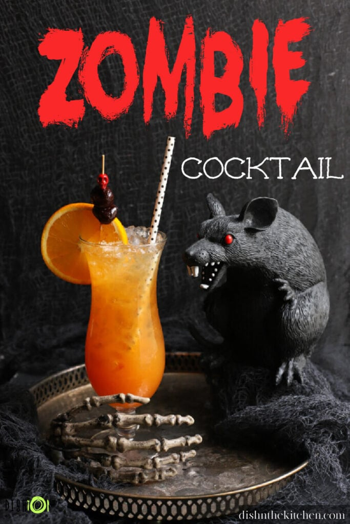 Pinterest image of a dark scene featuring a plastic black rat and an icy bright orange cocktail in a tall glass.