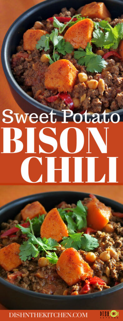 Pinterest image of a black bowl filled with ground bison chili, peppers, chick peas, and large orange sweet potato bites.