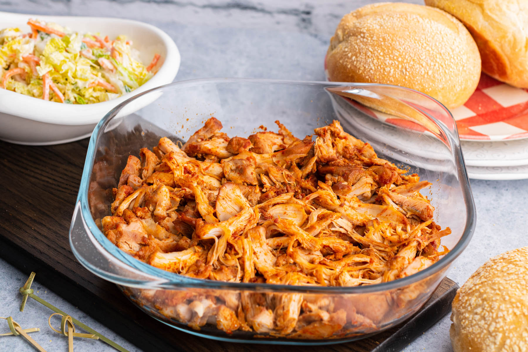 A glass dish filled with BBQ Pulled Chicken with no sauce.