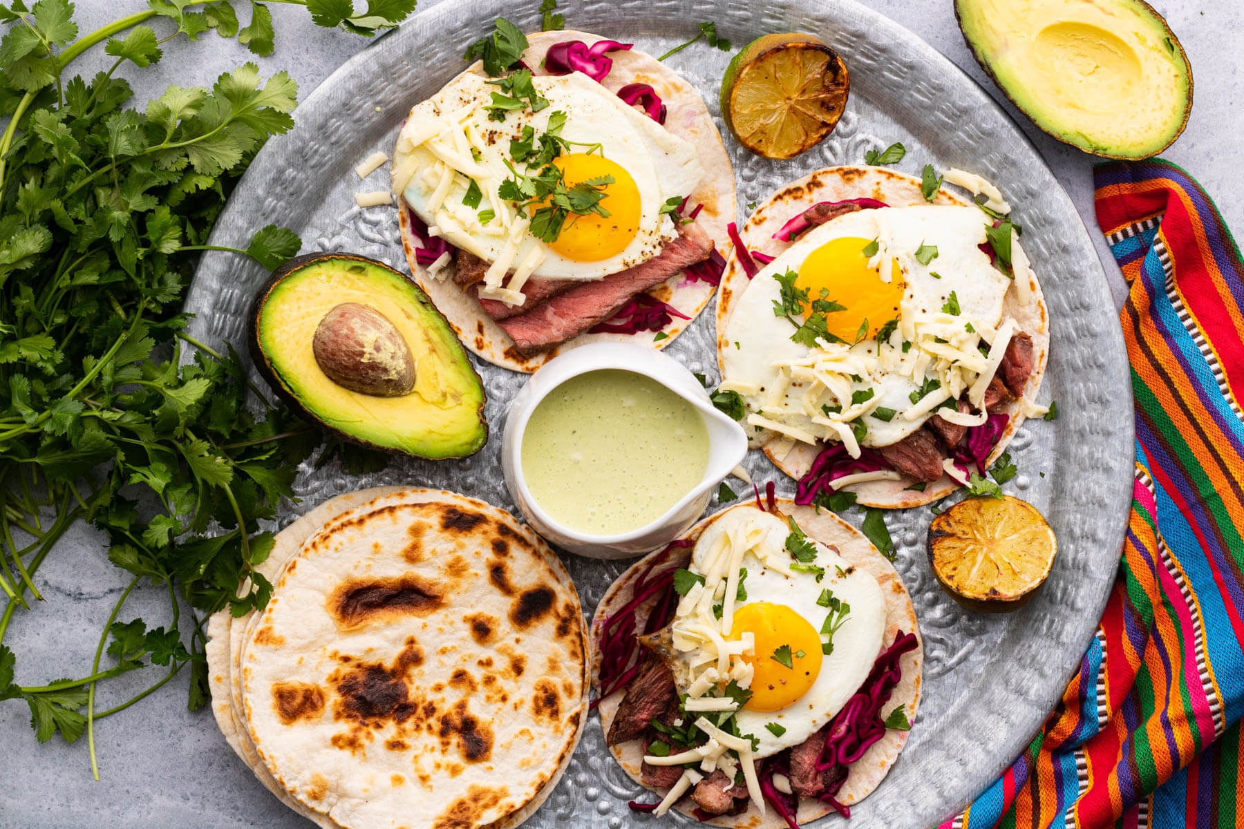 A tin platter of steak and egg tacos.