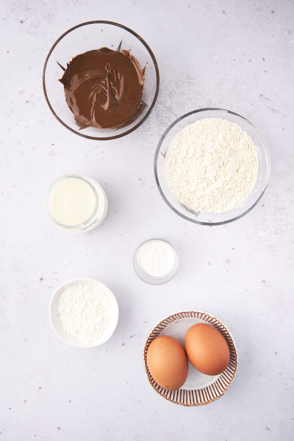 Ingredients needed to make Chocolate Baked donuts.