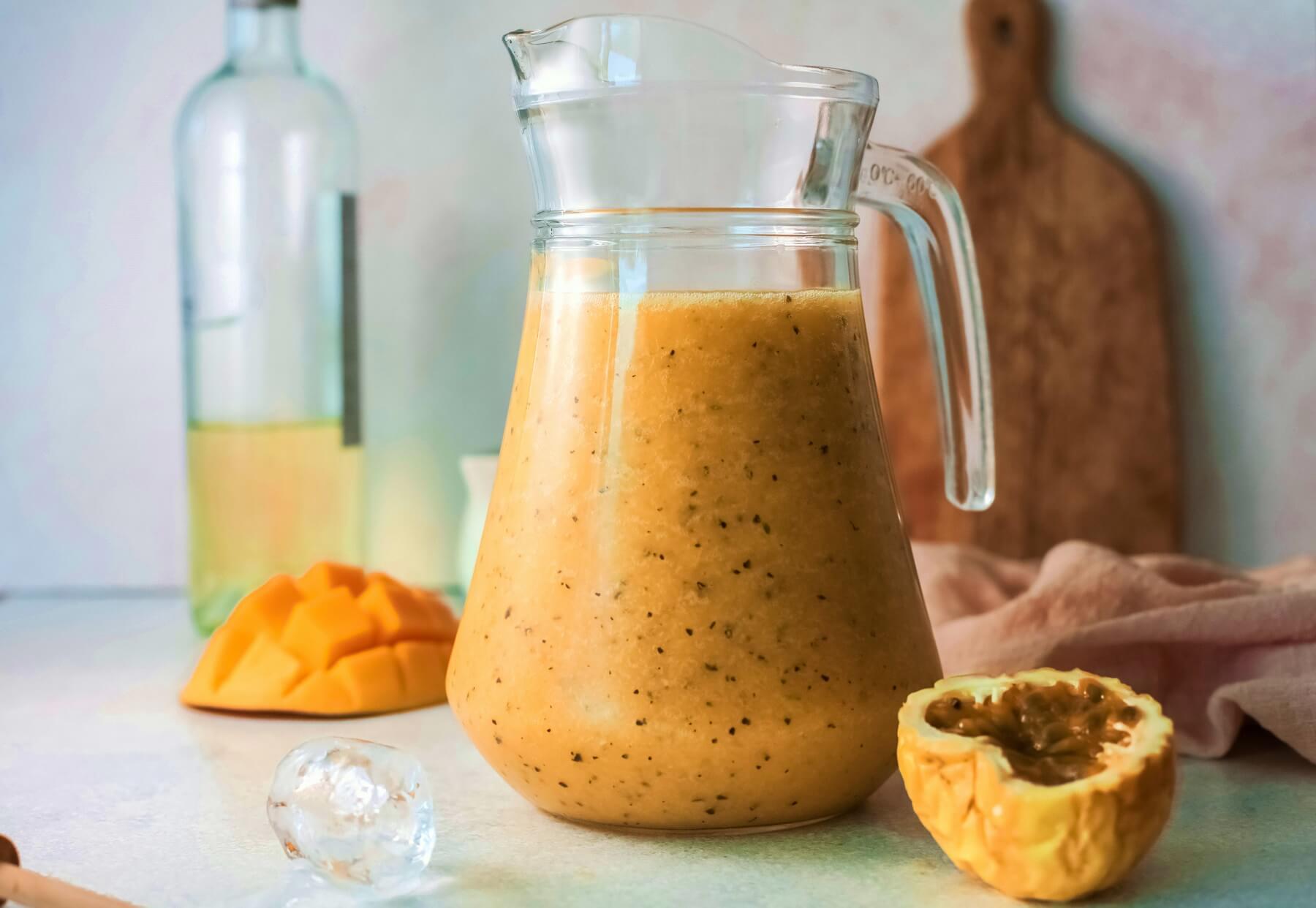 A pitcher full of orange coloured mango passionfruit wine slushie.