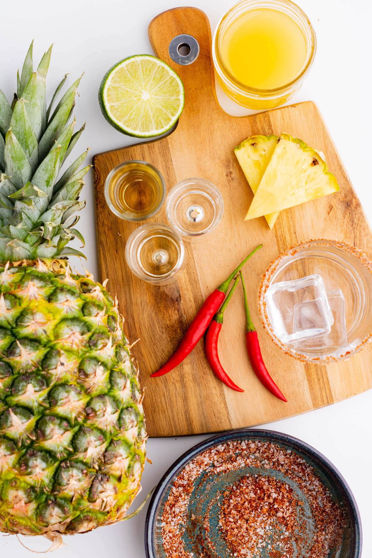 Ingredients used in making two spicy pineapple margaritas.