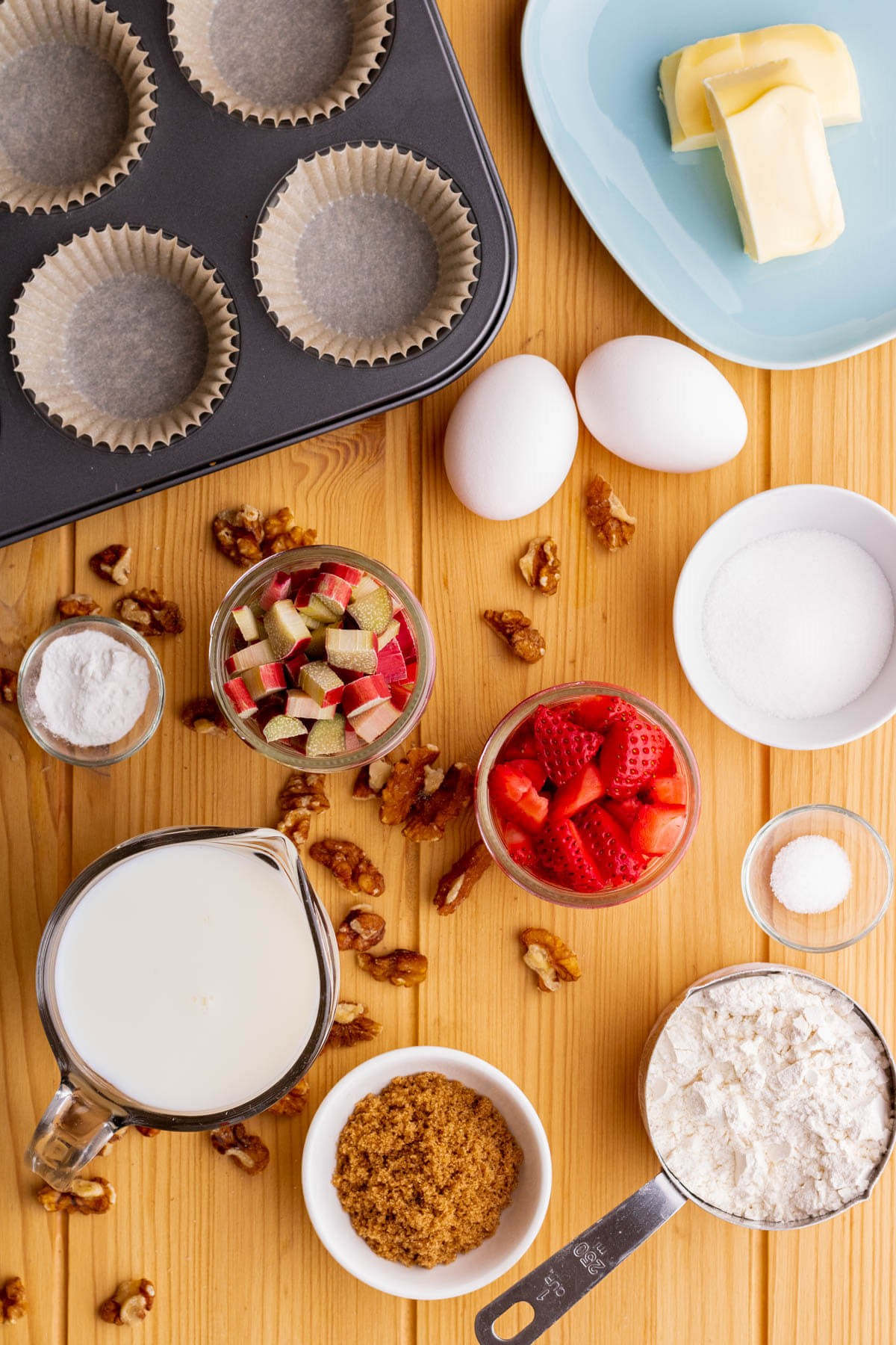Ingredients used in making strawberry rhubarb muffins with streusel topping.