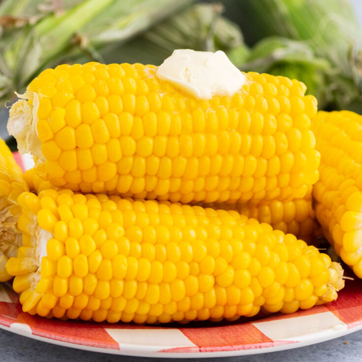 A golden yellow stack of cooked Instant Pot Corn on the Cob with butter.