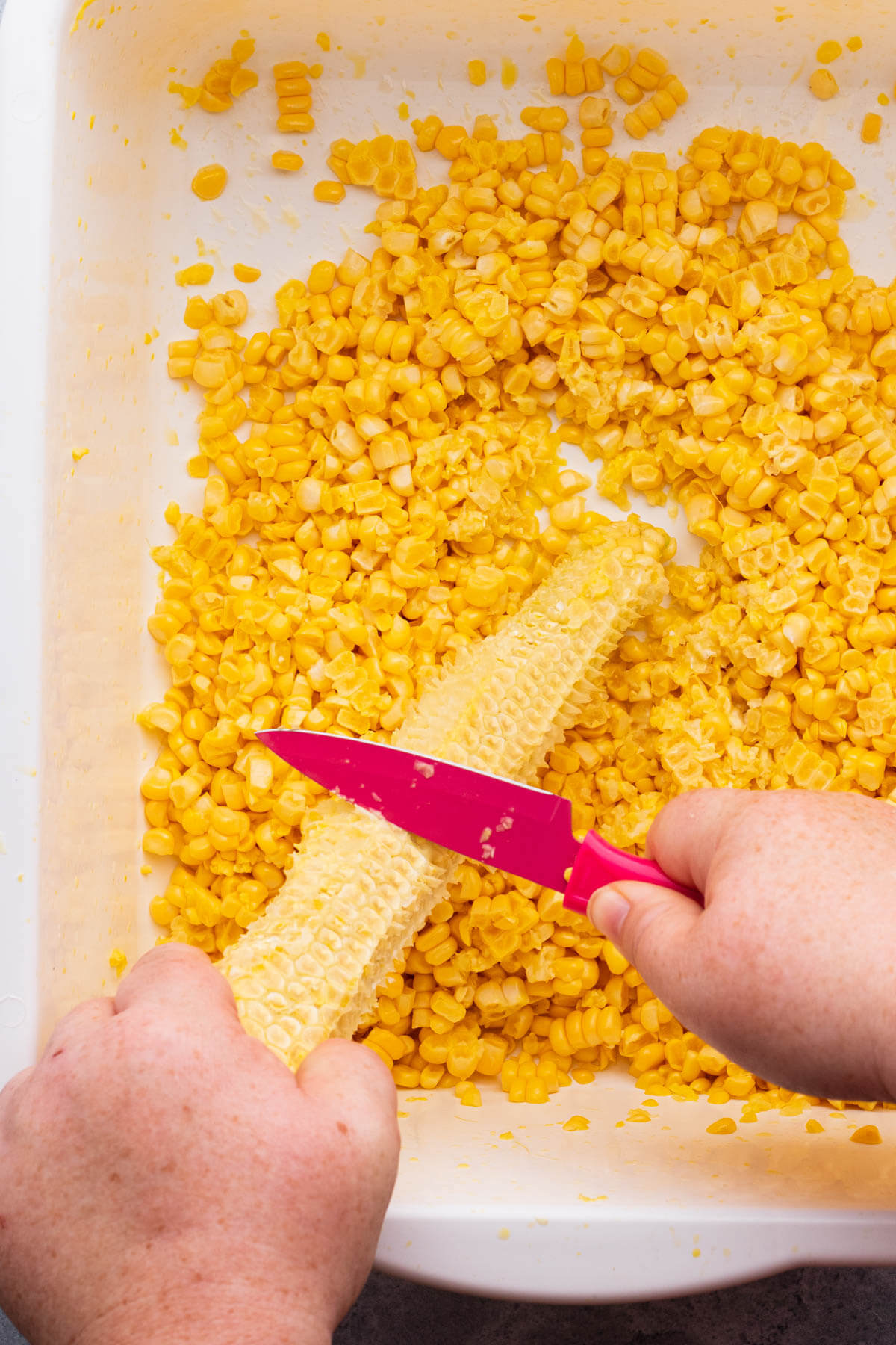 A demonstration of how to remove the 'cream' from a corn cob.