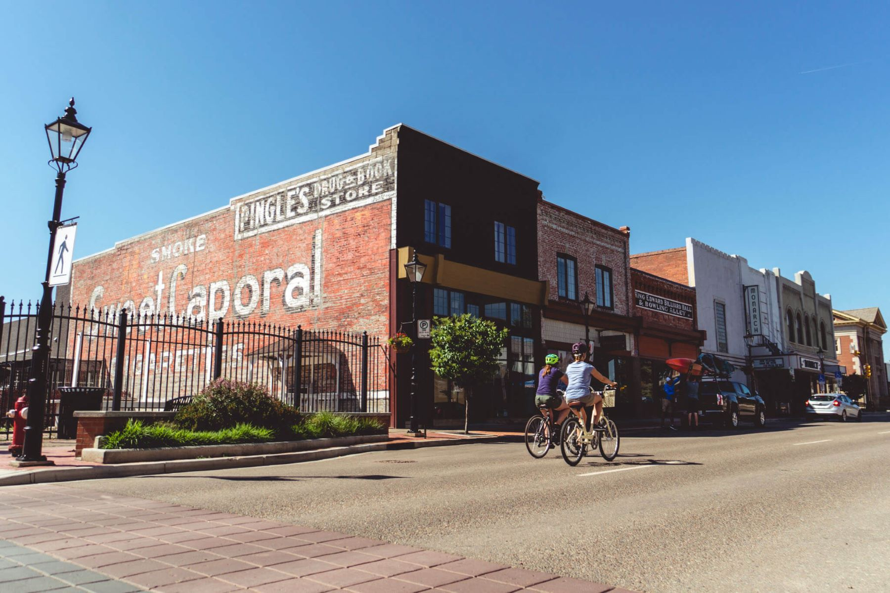 Street scene showing historic buildings and cyclists in Medicine Hat, Alberta.